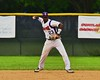 Cortland Crush Terrell Barringer (23) about to throw out the Syracuse Junior Chiefs player at First on Greg's Field at Beaudry Park in Cortland, New York on Saturday June 20, 2015. Cortland won 4-1.
