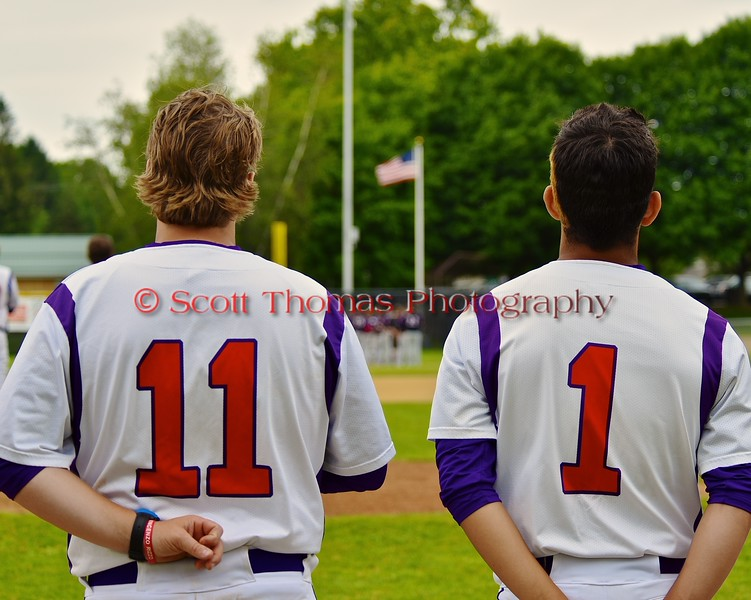 Cortland Crush Assistant Coach Matt Frey (11) and Crae Watkins (1) during the National Anthem before playing the Syracuse Junior Chiefs on Greg's Field at Beaudry Park in Cortland, New York on Saturday June 20, 2015.
