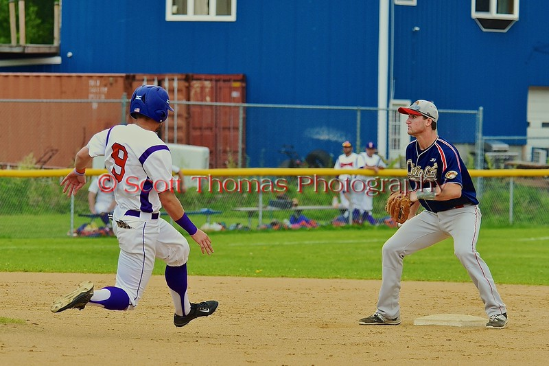 Cortland Crush Julian Gallup (9) on his way to stealing Second Base against the Syracuse Junior Chiefs on Greg's Field at Beaudry Park in Cortland, New York on Saturday June 20, 2015. Cortland won 4-1.