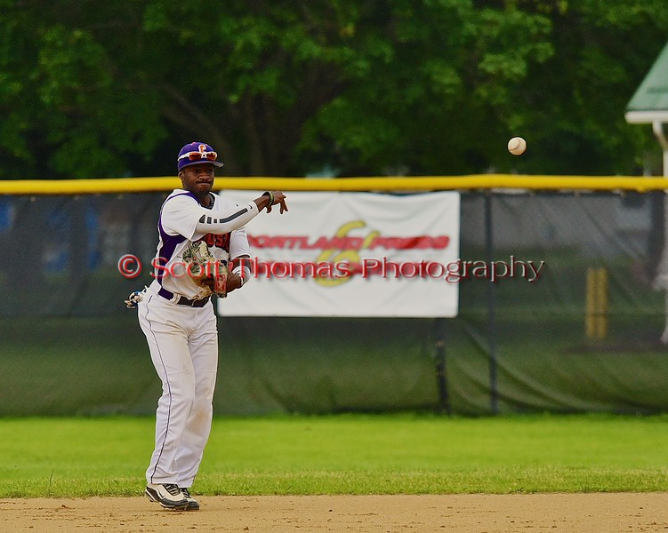 Cortland Crush Terrell Barringer (23) throws out the Syracuse Junior Chiefs player at First on Greg's Field at Beaudry Park in Cortland, New York on Saturday June 20, 2015. Cortland won 4-1.