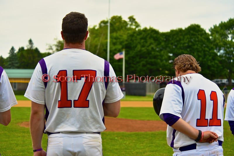 Cortland Crush Joseph Jones (17) and Assistant Coach Matt Frey (11) during the National Anthem before playing the Syracuse Junior Chiefs on Greg's Field at Beaudry Park in Cortland, New York on Saturday June 20, 2015.