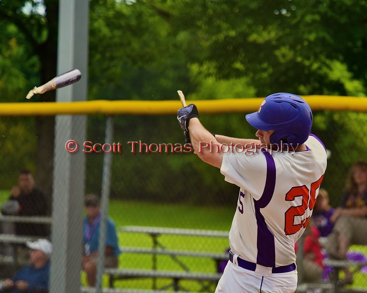 Cortland Crush Zephan Kash (25) breaks his bat while taking a swing against the Syracuse Junior Chiefs on Greg's Field at Beaudry Park in Cortland, New York on Saturday June 20, 2015. Cortland won 4-1.