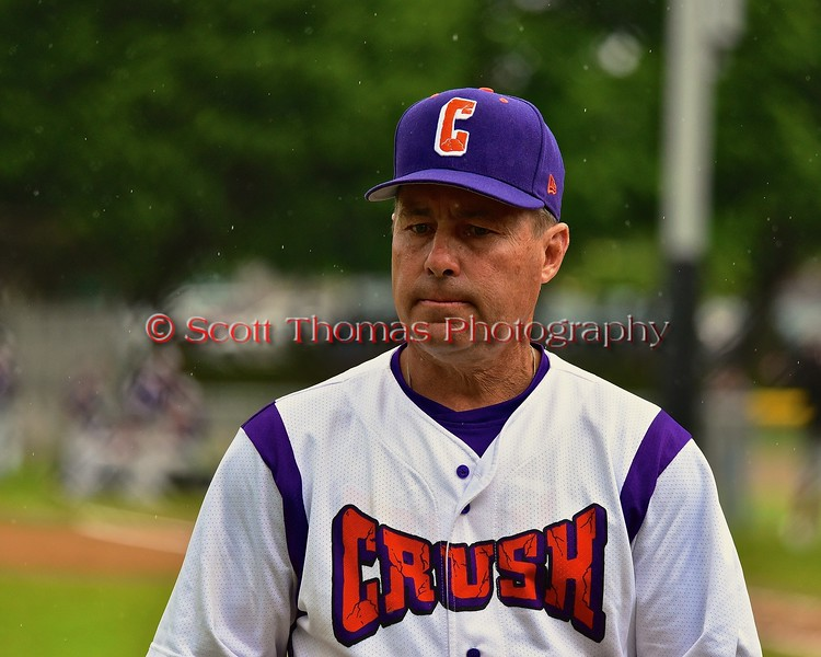 Cortland Crush Manager Bill McConnell walking back to the Dugout in a game against the Syracuse Junior Chiefs on Greg's Field at Beaudry Park in Cortland, New York on Saturday June 20, 2015. Cortland won 4-1.