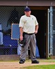 Umpire for the Cortland Crush and Oneonta Outlaws waiting for the start of the game on Greg's Field at Beaudry Park in Cortland, New York on Tuesday, June 23, 2015. Oneonta won 7-5.