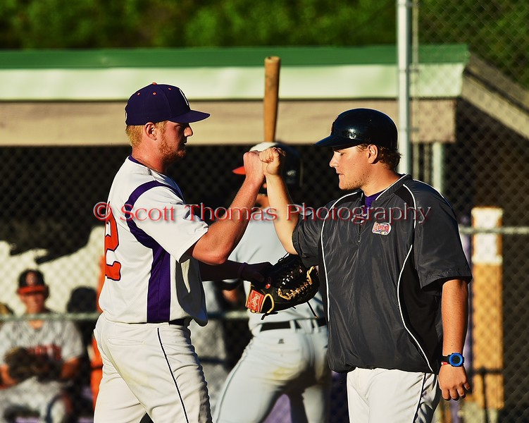 Cortland Crush Cody Barnes (42) gets a first bump from Assistant Coach Matt Frey (11) after pitching against the Oneonta Outlaws on Greg's Field at Beaudry Park in Cortland, New York on Tuesday, June 23, 2015. Oneonta won 7-5.