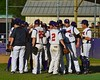 Cortland Crush huddle up against the Oneonta Outlaws on Greg's Field at Beaudry Park in Cortland, New York on Tuesday, June 23, 2015. Oneonta won 7-5.