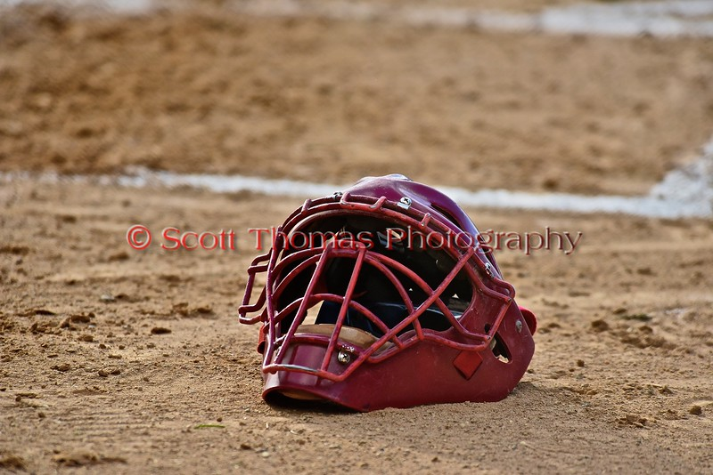 Oneonta Outlaws Catcher Jessey Valdez's (4) mask on Greg's Field at Beaudry Park in Cortland, New York on Tuesday, June 23, 2015. Oneonta won 7-5.
