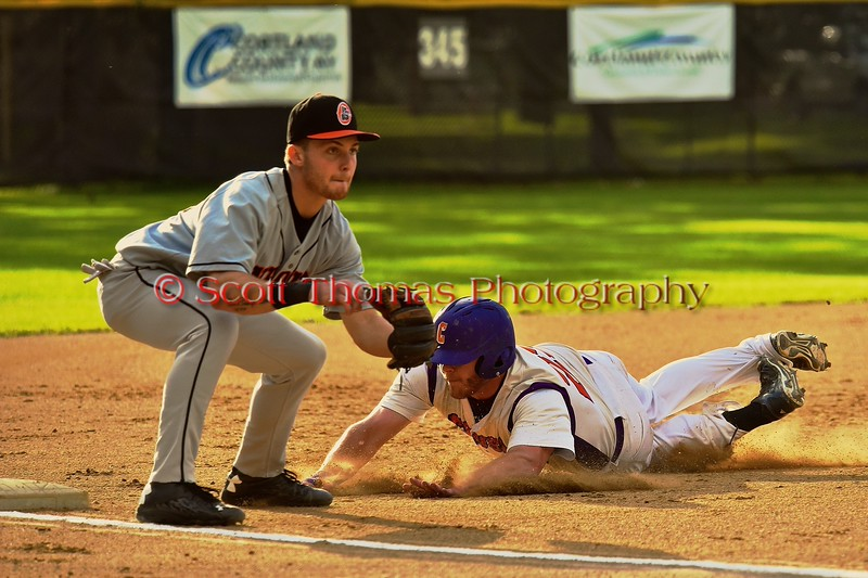 Cortland Crush Zephan Kash (25) slides into Third Base against the Oneonta Outlaws on Greg's Field at Beaudry Park in Cortland, New York on Tuesday, June 23, 2015. Oneonta won 7-5.