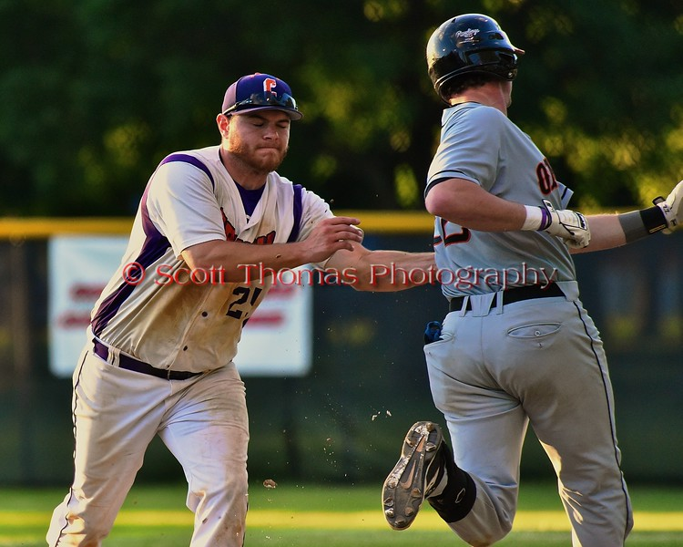 Cortland Crush Zephan Kash (25) tags the Oneonta Outlaws runner Zack Blonder (22) out on Greg's Field at Beaudry Park in Cortland, New York on Tuesday, June 23, 2015. Oneonta won 7-5.