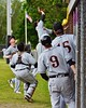 Oneonta Outlaws players go after a foul ball against the Cortland Crush on Greg's Field at Beaudry Park in Cortland, New York on Tuesday, June 23, 2015. Oneonta won 7-5.