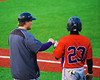 Cortland Crush Terrell Barringer (23) gets a fist bump from Assistant Coach Matt Frey (11) before his at bat against the Syracuse Salt Cats in Syracuse, New York on Monday, June 29, 2015. Cortland won 4-1.