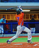 Cortland Crush Jose Arebalo (7) follows through on a hit against the Syracuse Salt Cats in Syracuse, New York on Monday, June 29, 2015. Cortland won 4-1.