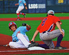 Cortland Crush Wesley Burghardt (8) tags out the Syracuse Salt Cats runner at Third Base in Syracuse, New York on Monday, June 29, 2015. Cortland won 4-1.