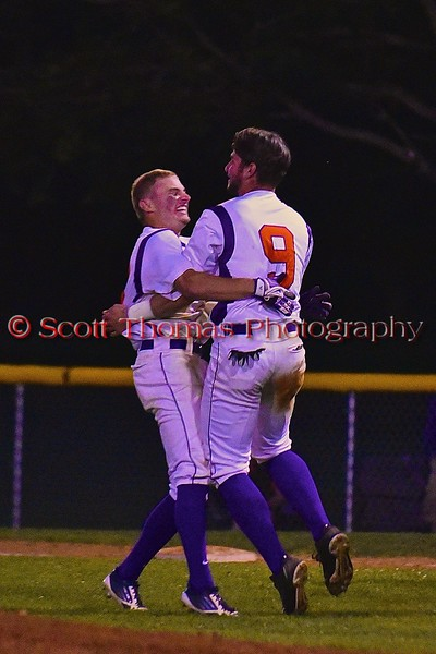 Cortland Crush Grant Hoover (18) and Julian Gallup (9) celebrate Hoover's Walk Off hit to get Gallup to score against the Sherrill Silversmiths on Greg's Field at Beaudry Park in Cortland, New York on Friday, July 10, 2015. Cortland won 8-7.