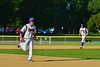 Cortland Crush Zephan Kash (25) and George Haaland (34) running the bases against the Sherrill Silversmiths on Greg's Field at Beaudry Park in Cortland, New York on Friday, July 10, 2015. Cortland won 8-7.