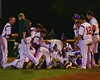 Cortland Crush players celebrate after a walk off hit by Grant Hoover (18) to defeat the Sherrill Silversmiths on Greg's Field at Beaudry Park in Cortland, New York on Friday, July 10, 2015. Cortland won 8-7.