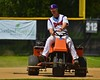 Cortland Crush Greg Jasek (14) racks the in-field before a game against the Sherrill Silversmiths on Greg's Field at Beaudry Park in Cortland, New York on Saturday, July 11, 2015.