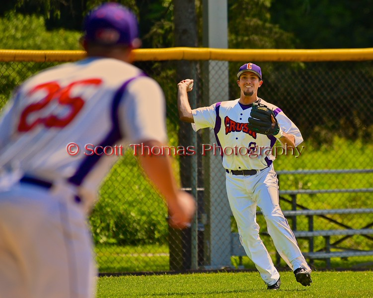 Cortland Crush Wesley Burghardt (8) throws out the Sherrill Silversmiths player at First on Greg's Field at Beaudry Park in Cortland, New York on Saturday, July 11, 2015. Cortland won 3-2.