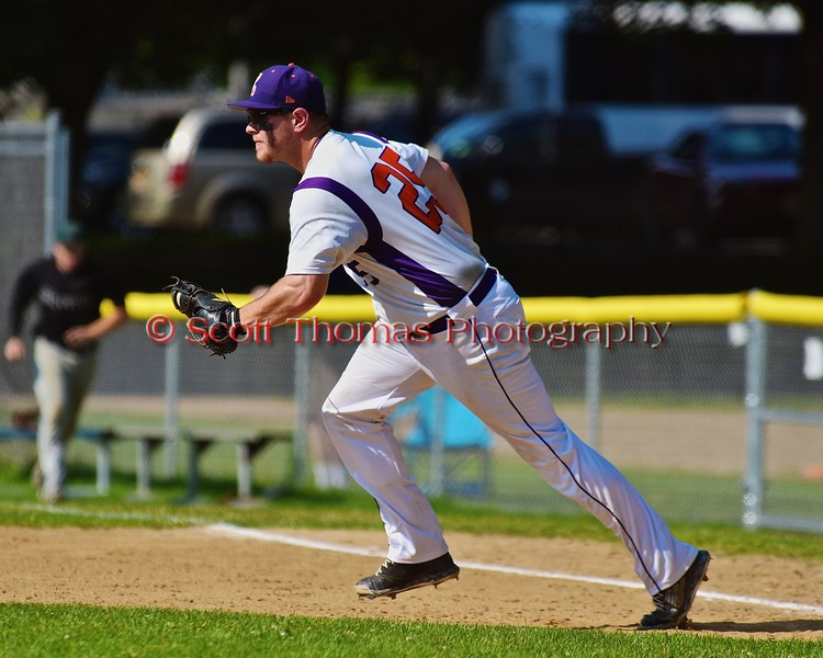 Cortland Crush Zephan Kash (25) gets the a Sherrill Silversmiths player in a run down on Greg's Field at Beaudry Park in Cortland, New York on Saturday, July 11, 2015. Cortland won 3-2.