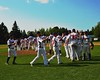 Cortland Crush players celebrate their win against the Sherrill Silversmiths on Greg's Field at Beaudry Park in Cortland, New York on Saturday, July 11, 2015. Cortland won 3-2.
