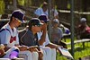 Cortland Crush Assistant Coach Matt Frey (11) and Head Coach Daniel Payne (44) watching the game against the Sherrill Silversmiths on Greg's Field at Beaudry Park in Cortland, New York on Saturday, July 11, 2015. Cortland won 3-2.