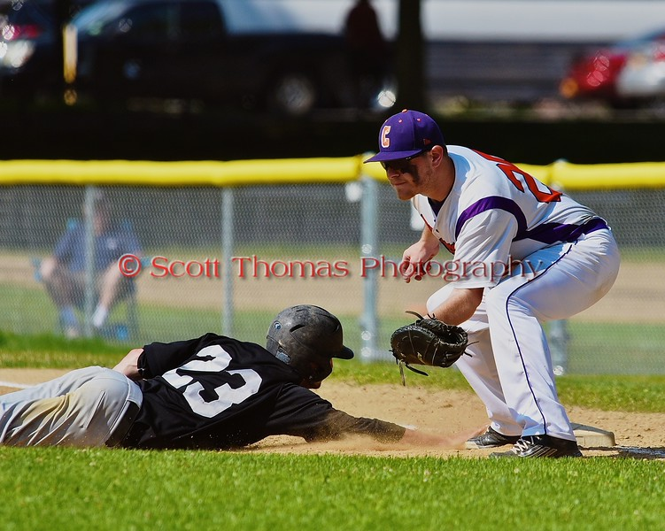 Cortland Crush First Baseman Zephan Kash (25) tries to tag out Sherrill Silversmiths Zach Taylor (23) on Greg's Field at Beaudry Park in Cortland, New York on Saturday, July 11, 2015. Cortland won 3-2.