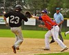 Cortland Crush Neil McCormack (12) about to catch then tag the Sherrill Silversmiths base runner on Greg's Field at Beaudry Park in Cortland, New York on Saturday, July 17, 2015. Cortland won 5-0.
