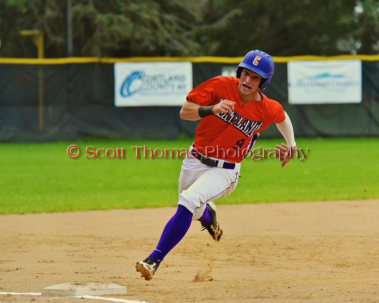 Cortland Crush Julian Gallup (9) rounds third base on his way to score a run against the Sherrill Silversmiths on Greg's Field at Beaudry Park in Cortland, New York on Saturday, July 17, 2015. Cortland won 5-0.
