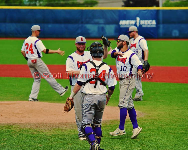 Cortland Crush players celebrate a win over the Syracuse Salt Cats in Syracuse, New York on Saturday, July 18, 2015. Cortland won 5-2.