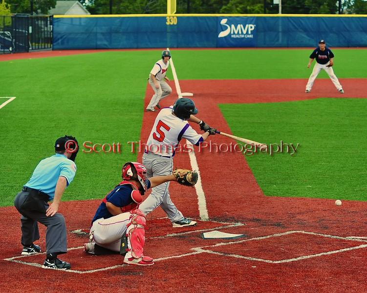Cortland Crush Matthew Alberino (5) gets a hit against the Syracuse Salt Cats in Syracuse, New York on Saturday, July 18, 2015. Cortland won 5-2.