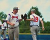 Cortland Crush pitchers Tyler Saundry (35) and Ben Barnes (19) great each other during a pitcher change against the Syracuse Salt Cats in Syracuse, New York on Saturday, July 18, 2015. Cortland won 5-2.