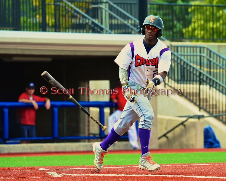 Cortland Crush Terrell Barringer (23) tosses his bat after being walking by a Syracuse Salt Cats pitcher in Syracuse, New York on Saturday, July 18, 2015. Cortland won 5-2.