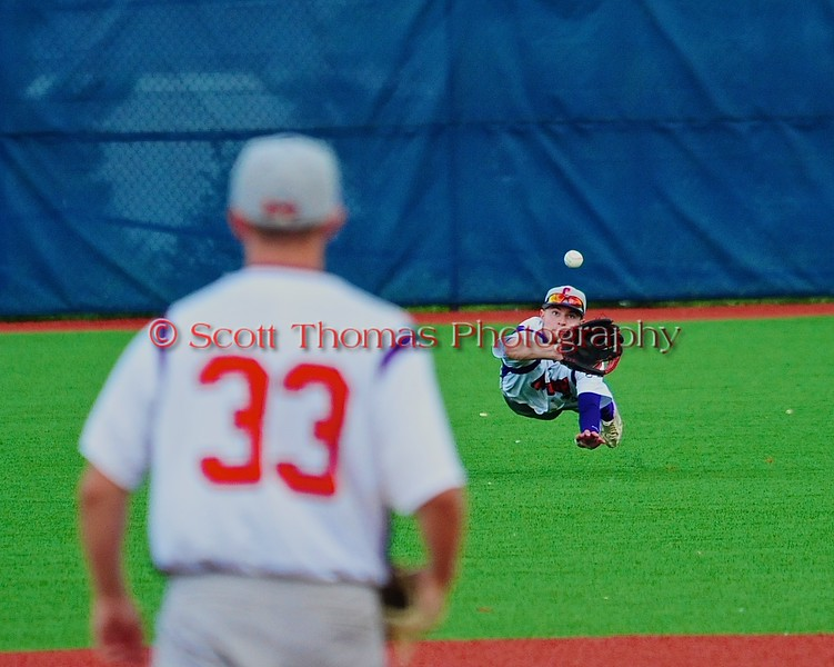 Cortland Crush Grant Hoover (18) lays out to catch the ball against the Syracuse Salt Cats in Syracuse, New York on Saturday, July 18, 2015. Cortland won 5-2.