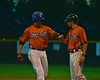 Cortland Crush Assistant Coach Myron Jellison (4) congratulates Sean Getman (24) for getting on base against the Syracuse Salt Cats on Greg's Field at Beaudry Park in Cortland, New York on Monday, July 20, 2015. Cortland won 3-2.
