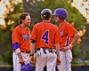Cortland Crush Assistant Coach Myron Jellison (4) talks with his base runners during a time out against the Syracuse Salt Cats on Greg's Field at Beaudry Park in Cortland, New York on Monday, July 20, 2015. Cortland won 3-2.