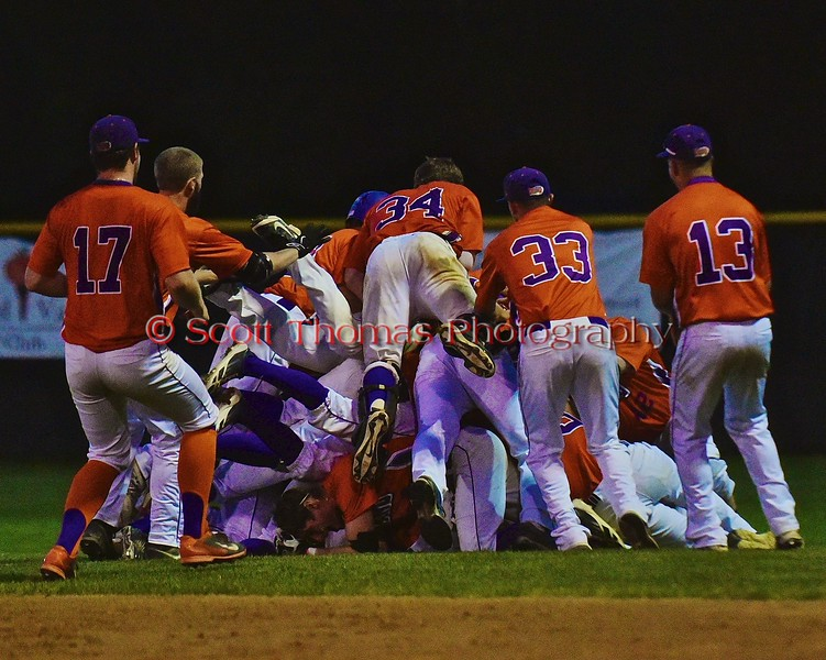 Cortland Crush players celebrate after defeating the Syracuse Salt Cats in the bottom of the 10th inning on Greg's Field at Beaudry Park in Cortland, New York on Monday, July 20, 2015. Cortland won 3-2.
