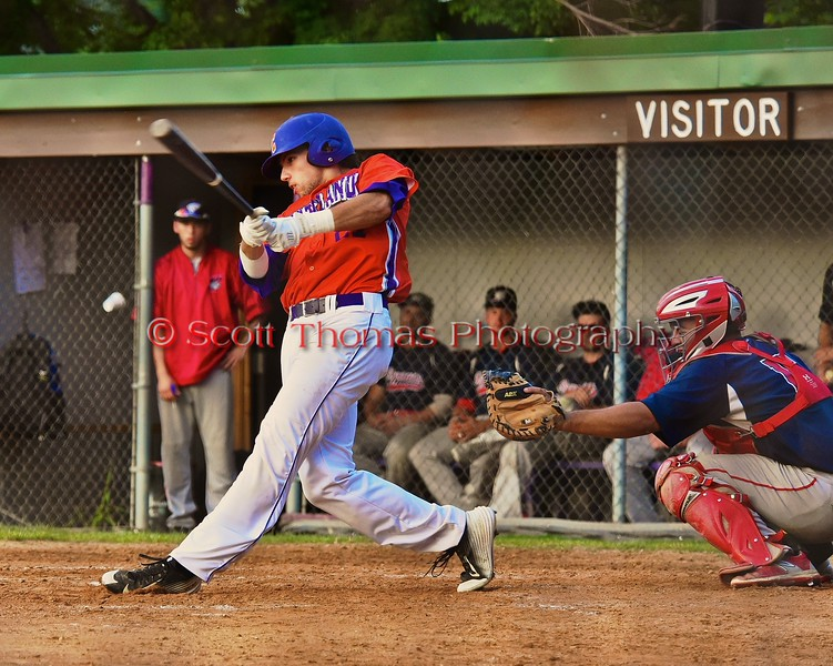 Cortland Crush Luke Gilbert (27) smacks the ball against the Syracuse Salt Cats on Greg's Field at Beaudry Park in Cortland, New York on Monday, July 20, 2015. Cortland won 3-2.