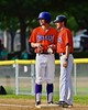 Cortland Crush Assistant Coach Myron Jellison (4) talks with Julian Gallup (9) during a time out against the Syracuse Salt Cats on Greg's Field at Beaudry Park in Cortland, New York on Monday, July 20, 2015. Cortland won 3-2.