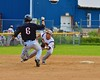 Cortland Crush Matthew Alberino (5) before getting the call to try to tag out Oneonta Outlaws Jordan Bradley (6) on Greg's Field at Beaudry Park in Cortland, New York on Thursday, July 23, 2015. Oneonta won 7-3.