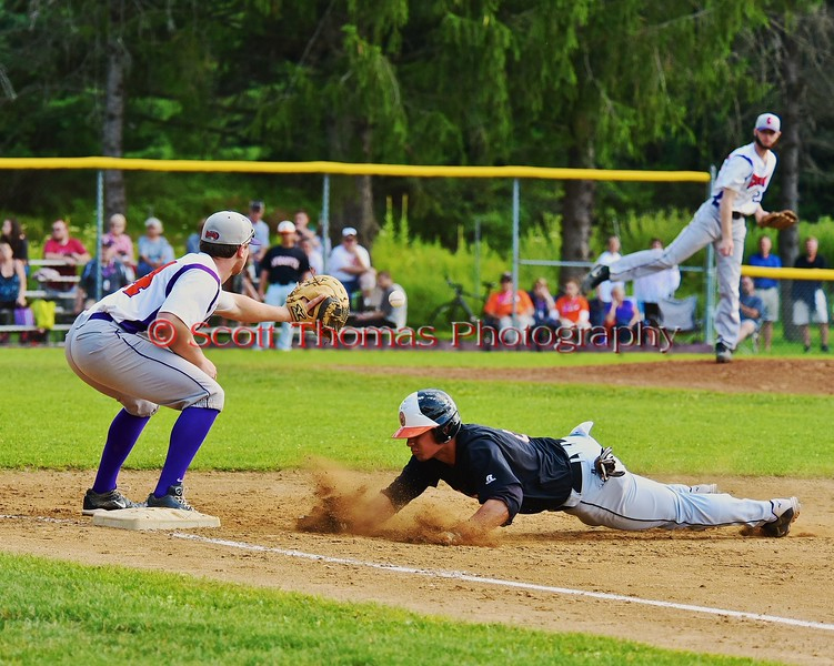 Cortland Crush Pitcher Yale Brian Hughes (28) keeping the Oneonta Outlaws base runner honest on Greg's Field at Beaudry Park in Cortland, New York on Thursday, July 23, 2015. Oneonta won 7-3.