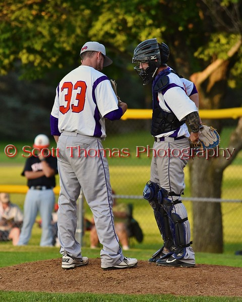 Cortland Crush Pitcher Patrick Graham (33) talks with Catcher Alex Loberger (21) before staring to pitch against the Oneonta Outlaws on Greg's Field at Beaudry Park in Cortland, New York on Thursday, July 23, 2015. Oneonta won 7-3.