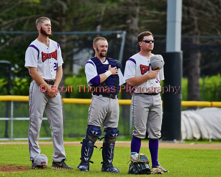 Cortland Crush players Yale Brian Hughes (28), Alex Loberger (21) and George Haaland (34) before playing the Oneonta Outlaws on Greg's Field at Beaudry Park in Cortland, New York on Thursday, July 23, 2015. Oneonta won 7-3.