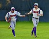 Cortland Crush Grant Hoover (18) and Julian Gallup (9) after ending an inning on a fly ball against the Oneonta Outlaws on Greg's Field at Beaudry Park in Cortland, New York on Thursday, July 23, 2015. Oneonta won 7-3.