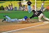 Cortland Crush Hank Pellicciotti (2) slides into Third Base before Oneonta Outlaws Cody Miller (12) can tag him on Greg's Field at Beaudry Park in Cortland, New York on Thursday, July 23, 2015. Oneonta won 7-3.