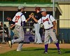 Cortland Crush Manager Bill McConnell fist bumps Luke Gilbert (27) after an inning against the Oneonta Outlaws on Greg's Field at Beaudry Park in Cortland, New York on Thursday, July 23, 2015. Oneonta won 7-3.