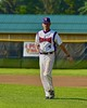 Cortland Crush Assistant Coach Myron Jellison (4) walks back to the dugout after preparing the field before playing the Oneonta Outlaws in a NYCBL Playoff game on Greg's Field at Beaudry Park in Cortland, New York on Monday, July 27, 2015.