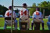 Cortland Crush Head Coach Daniel Payne (44), Greg Jasek (14) and Manager Bill McConnell watching the play against the Oneonta Outlaws in a NYCBL Playoff game on Greg's Field at Beaudry Park in Cortland, New York on Monday, July 27, 2015. Cortland won 4-3.