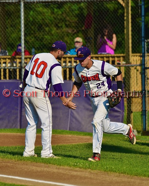 Cortland Crush Chris Rupprecht (10) greeting Sean Getman (24) before playing the Oneonta Outlaws in a NYCBL Playoff game on Greg's Field at Beaudry Park in Cortland, New York on Monday, July 27, 2015.