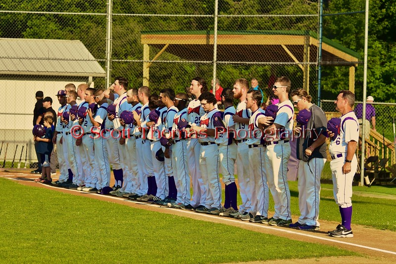 Cortland Crush players lined up on the Third Base during the playing of the National Anthem before playing the Oneonta Outlaws in a NYCBL Playoff game on Greg's Field at Beaudry Park in Cortland, New York on Monday, July 27, 2015.