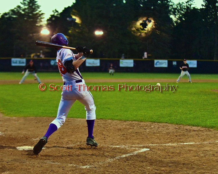 Cortland Crush Yale Brian Hughes (28) hits the ball for a Walk Off Single against the Oneonta Outlaws in a NYCBL Playoff game on Greg's Field at Beaudry Park in Cortland, New York on Monday, July 27, 2015. Cortland won 4-3.